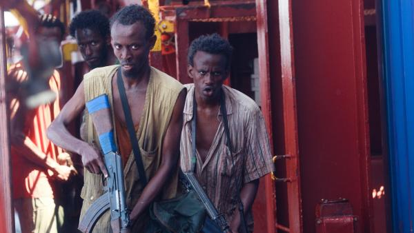 Barkhad Abdi (middle) plays Muse, the leader of a band of Somali pirates who take over a freighter in <em>Captain Phillips.</em>