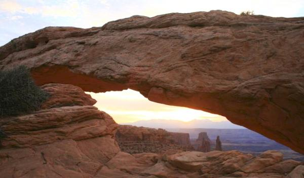 Dawn at Mesa Arch in Canyonlands National Park is a favorite moment for photographers from all over the world. They'll soon be able to return to the park, given Utah's deal with the Interior Department to fund park operations.