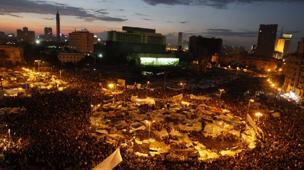 Anti-government demonstrators crowd Cairo's Tahrir Square in February 2011. A report from HSBC says Egypt and other Arab Spring countries will lose a total of $800 billion by the end of next year because of the unrest.