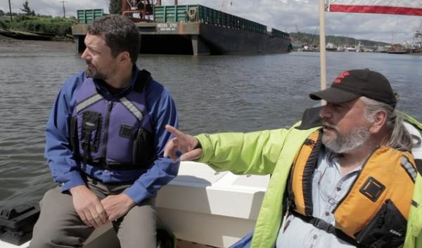 Chris Wilkeson (L) of Puget Soundkeeper Alliance, and James Rasmussen with Duwamish River Clean up Coalition, touring the Duwamish River in 2012. Wilke's group is among those suing Washington over pollution standards and fish consumption safety.