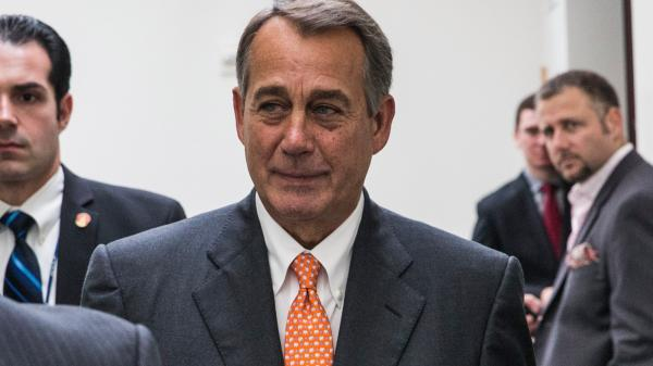Speaker of the House John Boehner leaves after discussing the government shutdown with his fellow Republicans on Capitol Hill Saturday. Boehner reportedly told his colleagues that talks with the White House had ended without a deal.