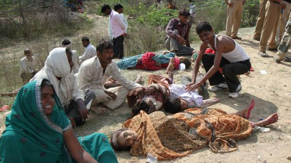 A stampede on a bridge outside a Hindu temple in India killed more than 100 people on Sunday. Many of the victims leapt to their deaths in the water below.