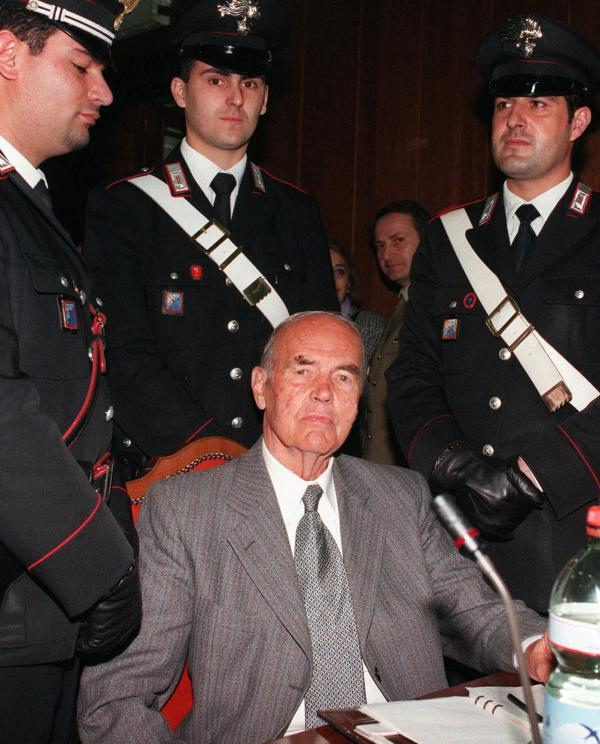 Former SS Captain Erich Priebke, seen here in Rome during his war crimes trial in 1996, died Friday at age 100. Authorities in Rome, Germany, and Argentina have rejected becoming his final resting place.