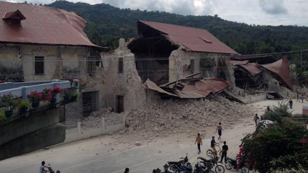 People inspect damage to the Church of San Pedro in the town of Loboc, Bohol, after a powerful earthquake struck the region early on Tuesday. The quake hit near one of the Philippines' key tourist hubs, the U.S. Geological Survey reported.