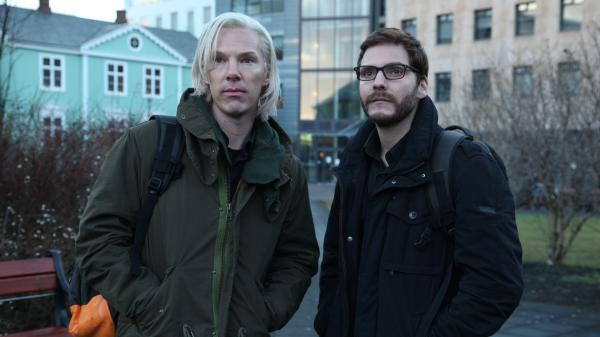 Benedict Cumberbatch (left), sporting the white-blond mop of the real Julian Assange, and Daniel Bruhl, who plays Daniel Domscheit-Berg, take on the story of WikiLeaks in <em>The Fifth Estate.</em>