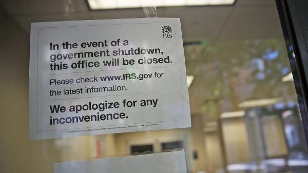 IRS offices around the country, like this one in Brooklyn, N.Y., have been closed since the partial government shutdown began two weeks ago. While the agency continues to cash checks from payees, refunds, audits and most other operations are suspended.