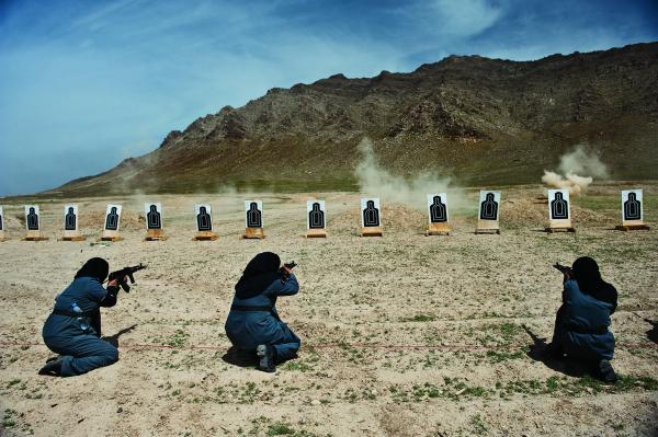 Women — mostly widows — train for police force jobs at a firing range near Kabul.