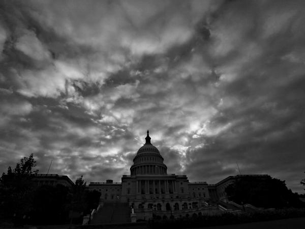Cloudy skies shroud the Capitol on Monday. Congress is at an impasse as Democrats and Republicans remain at odds over the crises gripping the nation.