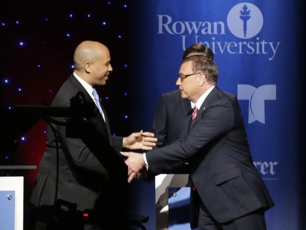 Democrat Cory Booker and Republican Steve Lonegan shake hands at the start of the final debate of their U.S. Senate campaign, last week at Rowan University in Glassboro, N.J.