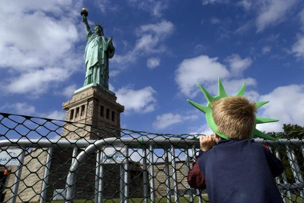 Jackson Blendowski, 6, peers up at the Statue of Liberty in New York Harbor on Oct. 13. The Statue of Liberty reopened to the public after the state of New York agreed to shoulder the costs of running the site during the shutdown.