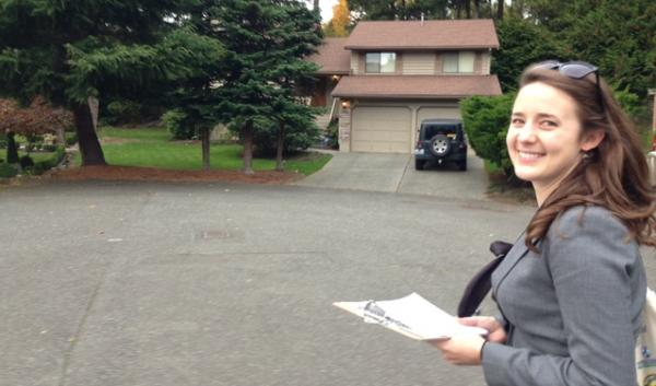 Isabel VanDerslice volunteers for Washington Conservation Voters going door to door in Bellingham to talk to people about the importance of the Whatcom County Council election in the future of the Gateway Pacific Terminal.