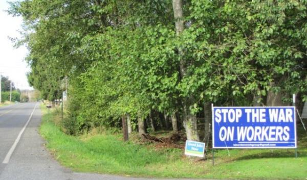 Signs like this one that support and others that oppose the Gateway Pacific Terminal dot the lawns of Whatcom County.