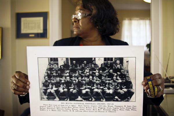 Deirdre Guyton, the school's director of alumni affairs, is proud of Bluefield State College's history and wants to preserve it. Here, she holds up a photo of the school's football team from 1927 to 1928, when it was the best black college team.