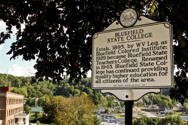 Bluefield State College is carved into the side of a hill overlooking the train tracks and the town below. This is one of two signs about the school's history that sit at the very top of campus.