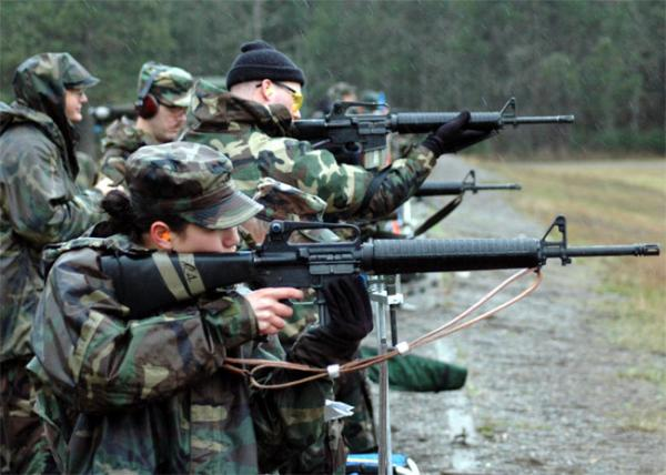 File photo of personnel from the Army, Navy and Washington State National Guard conducting a weapons qualification exercise at Fort Lewis, Wash.