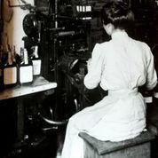 A woman places labels on Old Crow bourbon bottles sometime in the early 1900s.