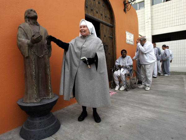 Sister Antonia Brenner touches the statue of San Pablo Encandenado (St. Paul chained) outside the chapel at La Mesa State Penitentiary in Tijuana, Mexico, in 2005.