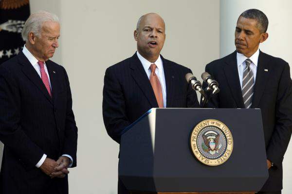 President Obama stands with Jeh Johnson, his choice for the next Homeland Security secretary, and Vice President Joe Biden, in the White House Rose Garden on Friday.