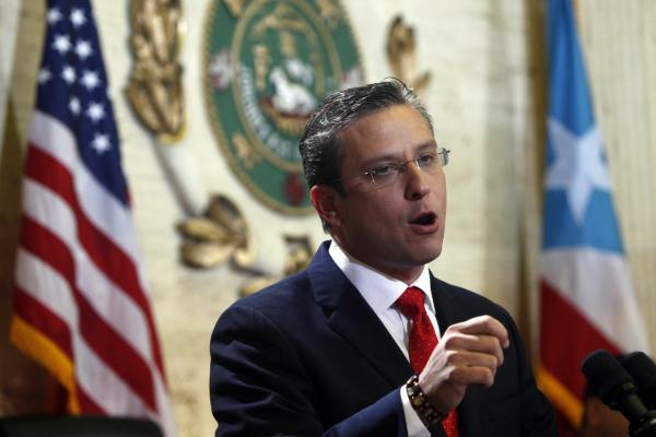 Puerto Rico Gov. Alejandro Garcia Padilla speaks during a state of the commonwealth address at the Capitol building in San Juan, Puerto Rico in April, 2013. (AP/Ricardo Arduengo)