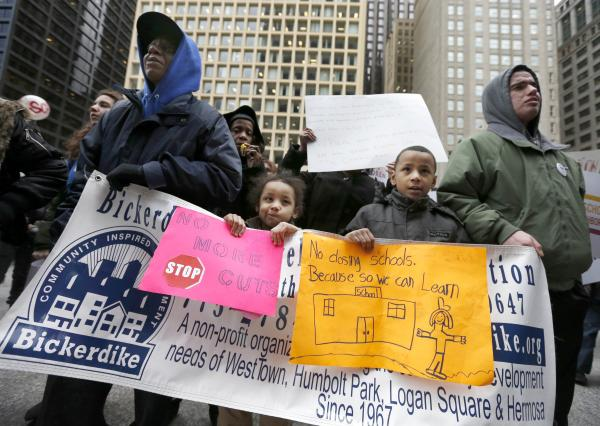 Members of the Chicago Teachers Union, parents, students and other opponents of a plan to close scores of Chicago public schools march through downtown Chicago in March. In the end, the city closed 50 schools, mostly in low-income communities.