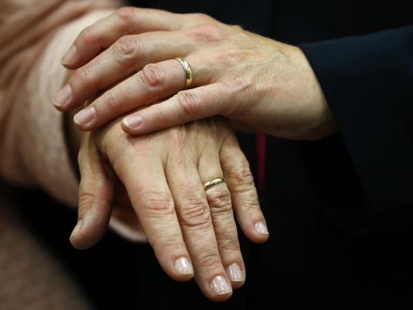 The hands of Beth Asaro, left, and Joanne Schailey after they exchanged vows to become the first same-sex couple married in Lambertville, N.J., early Monday.