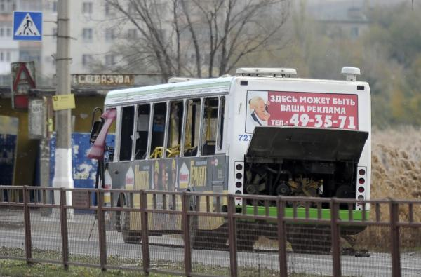 A damaged bus is examined by experts in Volgograd on Monday.