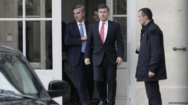 U.S. Ambassador to France Charles Rivkin (in red tie) leaves the Foreign Ministry in Paris after being summoned Monday following reports that the National Security Agency spied on French citizens.
