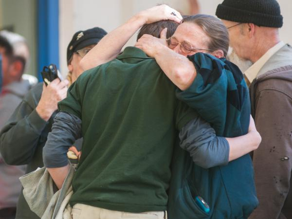 A Sparks Middle School student cries with family members after a fellow student killed a math teacher and himself Monday in Sparks, Nev.