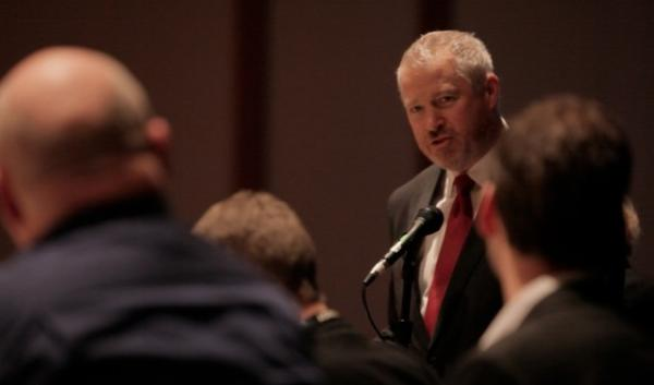 Seattle Mayor Mike McGinn wants his city and other local governments to divest from fossil fuel stocks. He's pictured speaking out against coal export terminals at a coal export hearing in Seattle in December, 2012.