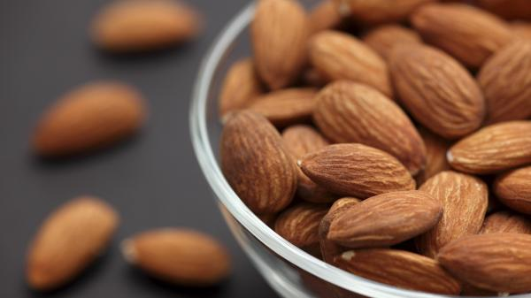 The protein, unsaturated fat composition and fiber in almonds all very likely play a role in helping to curb appetites.