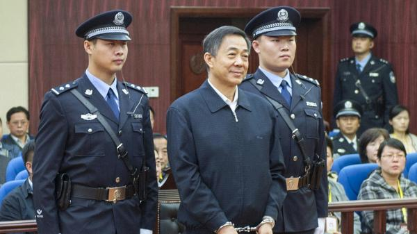 In this photo released by China's Xinhua News Agency, ousted Chinese politician Bo Xilai stands before the Shandong Provincial Higher People's Court. The court upheld Bo's conviction and life sentence for corruption and abuse of power.