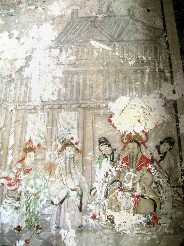 This 2011 photo shows one of the ancient frescoes in Yunjie temple that now are covered by cartoonlike paintings.