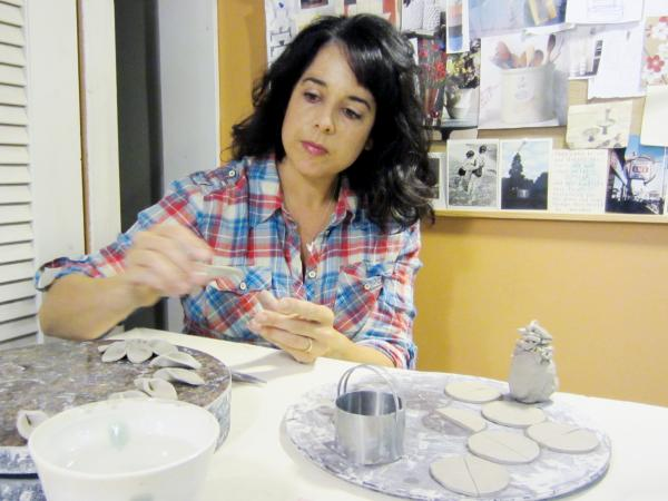 "Rae Padulo creates handmade ceramics, like these holiday ornaments, for her Etsy-based company, mudstar ceramics. She's disappointed with the site's new policy to allow outsourced manufacturing. ""There's nothing wrong with factory-made,"" she says, but ""that's not what Etsy started out to be."""