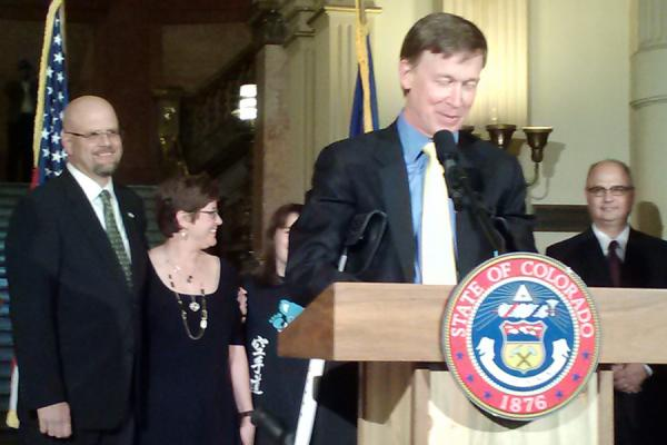 William Hood and his wife look on as Gov. Hickenlooper announces his appointment, Oct. 25.