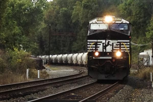 A Norfolk Southern train pulls oil tank units on its way to the PBF Energy refinery in Delaware City, Del. As U.S. oil production outpaces its pipeline capacity, more and more companies are looking to the railways to transport crude oil.