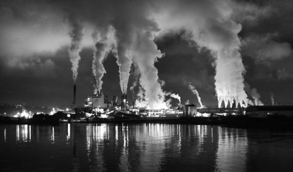 Smoke stacks during a night scene in Tacoma, Wash. The governors of California, Washington and Oregon and the premier of British Columbia announced on Oct. 28, 2013 their plan to align strategies to curb greenhouse gas emissions.