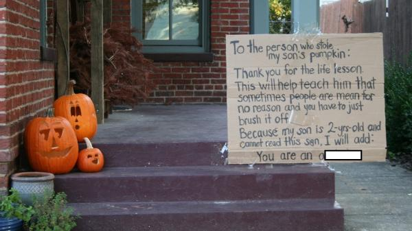 The sign to shame a pumpkin thief (with a rather mild expletive digitally hidden).