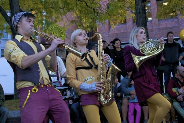 Members of Perhaps Contraption, from left, Jin Theriault, Charly Webber and Emily Cunliffe, performing at Harvard Square as part of the Honk Festival in Cambridge, Mass. (Qainat Khan/Here & Now)