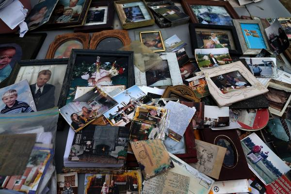 Old photographs are laid out on a car hood to dry after being removed from a flooded home in Seaside Heights, N.J. At the time, New Jersey Gov. Chris Christie estimated that Superstorm Sandy had cost his state $29.4 billion in damage and other economic losses.