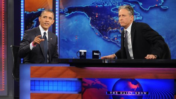 Jon Stewart, shown here interviewing President Obama on <em>The Daily Show</em> in October 2012, has been lampooning the problems with the Affordable Care Act website in recent episodes.