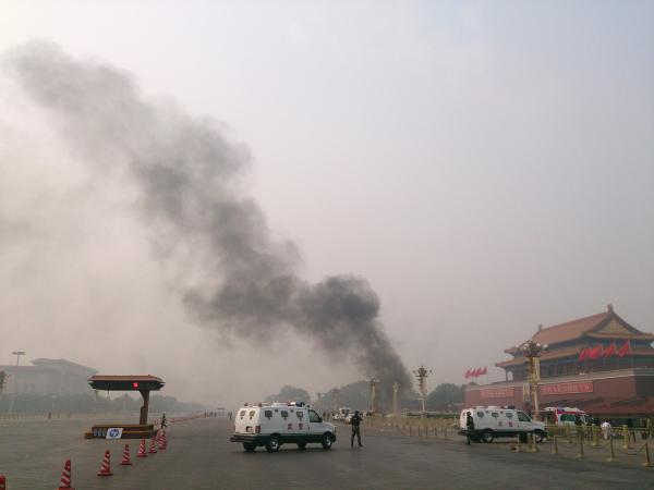 Police cars block off the roads leading into Tiananmen Square as smoke rises into the air after a vehicle crashed in front of Tiananmen Gate in Beijing on Oct. 28.