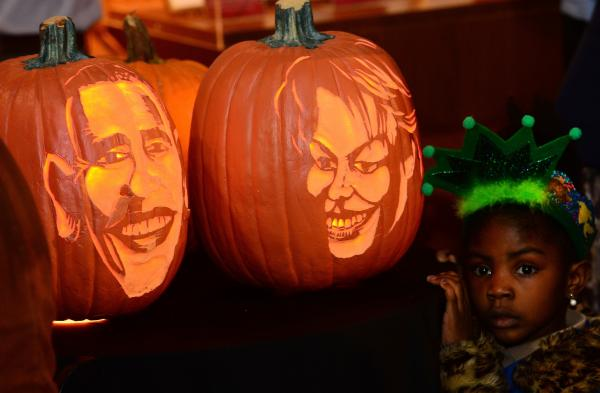 Pumpkins with likenesses of President Obama and First Lady Michelle Obama on display at Madame Tussauds in New York, October 22, 2013.