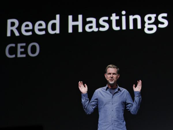<p>Netflix has backed off its unpopular plan to split its service into two offerings — one for streaming video, and one for sending DVDs by mail. CEO Reed Hastings is seen gesturing in this file photo.</p>