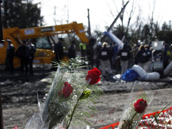 Feb. 16, 2009: Flowers are left in memorial near where Continental Connection Flight 3407 crashed in Clarence, N.Y. Fifty people died. Pilot fatigue was cited as a factor.