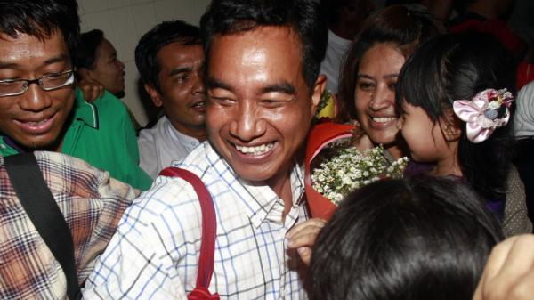 Zaw Thet Htway, center, a journalist who was arrested during the 2007 Saffron Revolution is welcomed by his colleagues as he arrives at Yangon airport after being released from prison on Friday in Yangon, Myanmar.