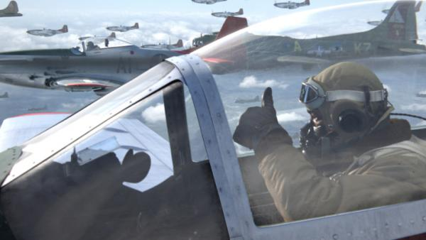"Escorting a squadron of bombers, Andrew ""Smokey"" Salem (Ne-Yo) signals fellow pilots on the way into combat with German forces in the new film <em>Red Tails</em>, based on the experiences of the famed Tuskegee Airmen fighter group."