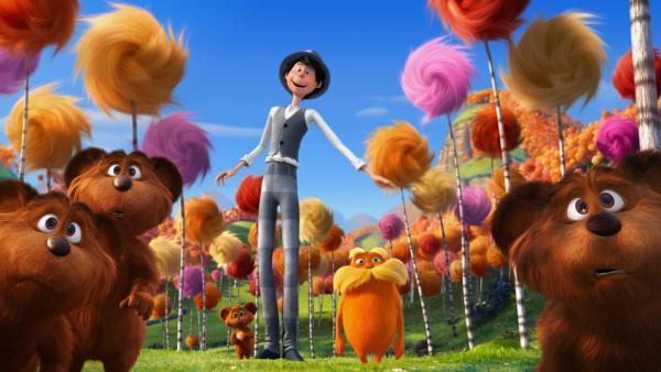 The Once-ler (voiced by Ed Helms) and the Lorax (Danny DeVito) are surrounded by bar-ba-loots in Truffula Valley in <em>Dr. Seuss' The Lorax</em>.