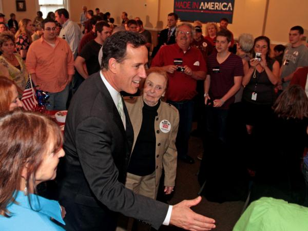Rick Santorum greets supporters during a rally at Lookout Steakhouse in Gulfport, Miss., on Sunday.