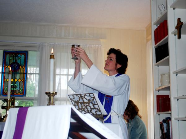 The Rev. Lucia Lloyd leads a service in the rental that housed the St. Stephen's Episcopal Church after the congregation split in 2006.
