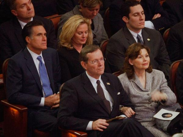 Mitt and Ann Romney sit behind Michael Leavitt and his wife Jacqueline at the February 2008 funeral of Gordon B. Hinckley, leader of the Church of Jesus Christ of Latter-day Saints. Romney reportedly has chosen Leavitt to lead his transition team.